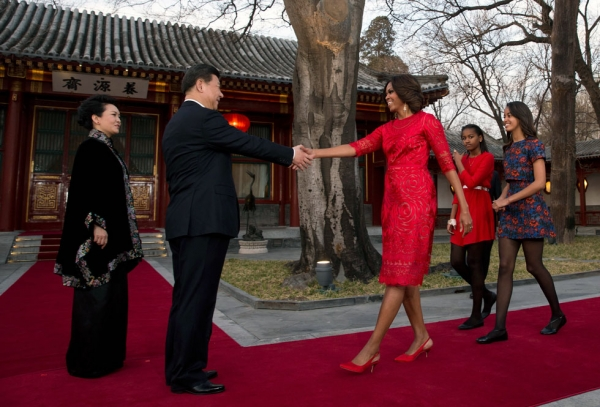 Michelle Obama, with her daughters Malia (R) and Sasha (2nd R), greets Chinese President Xi Jinping and his wife Peng Liyuan (L) in front of the Diaoyutai State guest house in Beijing on March 21, 2014. (Andy Wong-Pool/Getty Images)