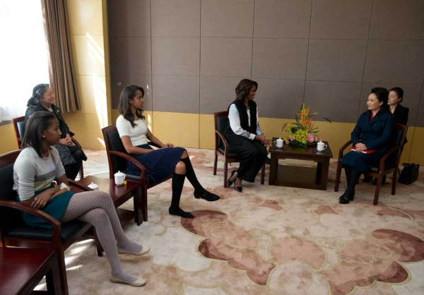 Michelle Obama (C), her daughters Sasha (L) and Malia (2nd L) meet with Peng Liyuan, wife of Chinese President Xi Jinping, on a visit the Beijing Normal School, which prepares students to attend university abroad, in Beijing on March 21, 2014. (Andy Wong-Pool/Getty Images)