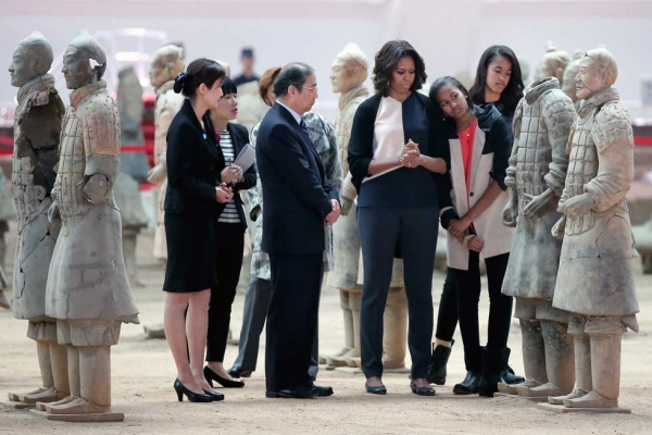 First Lady Michelle Obama (3rd R) with her daughters Malia Obama (R) and Sasha Obama (2nd R) visit the Museum of Terracotta Warriors during a visit to the historic excavation site in Xi'an on March 24, 2014. (Feng Li/Getty Images)