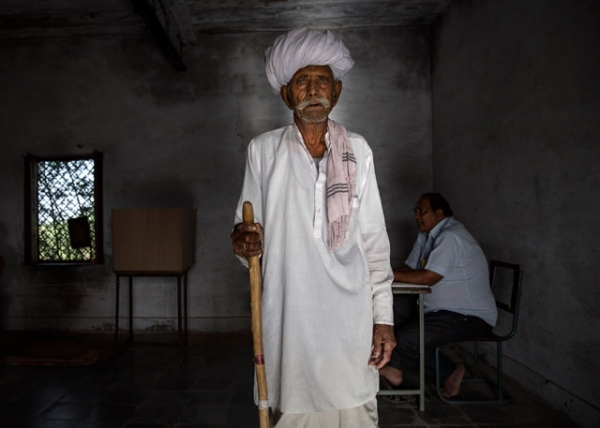 An Indian man pauses after voting at a polling station on April 17, 2014 in the Jodhpur District in the desert state of Rajasthan, India. (Kevin Frayer/Getty Images)