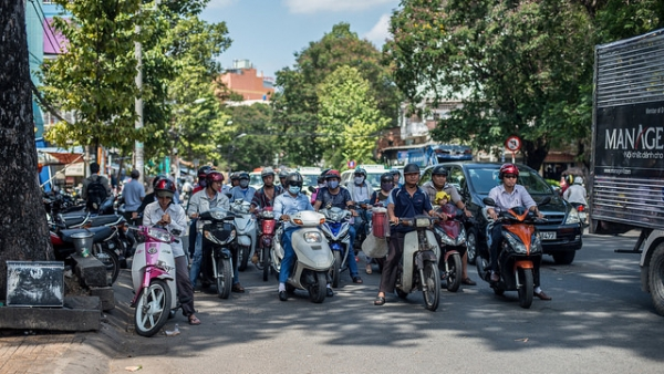 Rush hour takes on a new twist in Ho Chi Minh City, Vietnam as the streets are dominated by two wheeled vehicles on May 5, 2014. (hermitsmoores/Flickr)