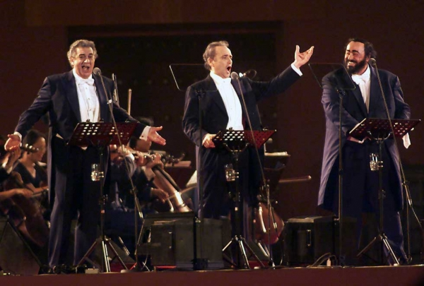 "L to R: ""Three Tenors"" Placido Domingo, Jose Carreras, and Luciano Pavarotti, shown here at Beijing's Forbidden City on June 23, 2001, helped rekindle Chinese interest in Western opera in the decades following the Cultural Revolution. (Stephen Shaver/AFP/Getty Images)"