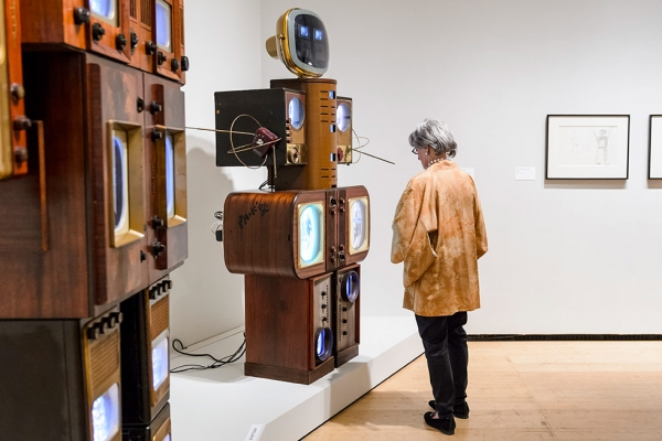 An Asia Society Museum goer takes in 'Nam June Paik: Becoming Robot,' on view through January 4, 2015. (C. Bay Milin/Asia Society)