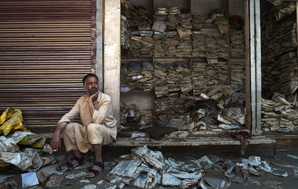 A Kashmiri shopkeeper reacts as he sits alongside a flood-damaged garment shop at the Lal Chowk area in Srinagar on September 17, 2014. (Dibyangshu Sarkar/AFP/Getty Images)