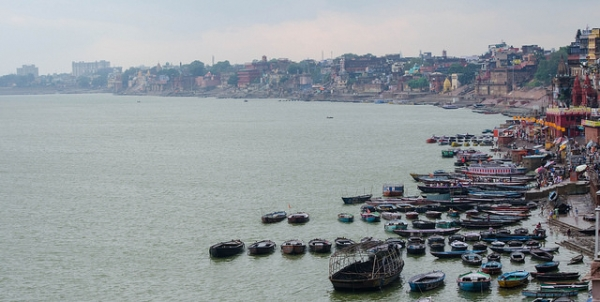 A variety of boats float in the vast waters of Varanasi on October 14, 2014. (ColWoods/Flickr)
