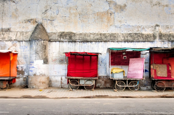 A group of pushcarts are neatly lined up against a decaying wall in Rajasthan, India on November 3, 2014. (Sven Van Echelpoel/Flickr)