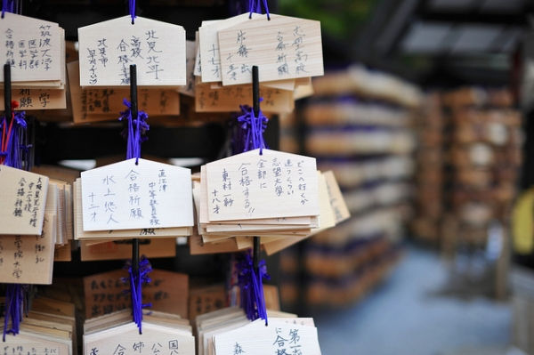 Small wooden plates with wishes written in ink hang from purple strings in Shibuya, Japan on November 14, 2014. (Shibuya246/Flickr)