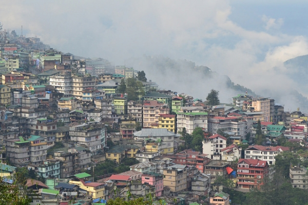 From a distance, the colorful buildings lining a valley look like a pack of boxes in Gangtok, Sikkim on May 8, 2014. (Kartik MS/Flickr)