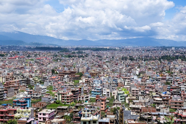 Against Nepal's mountainous skyline, multicolored residencies populate the land. (Eugene Kaspersky/Flickr)