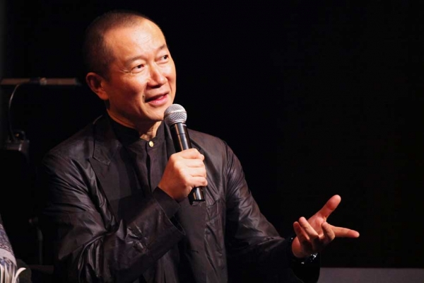 Composer Tan Dun, Head of the Artistic Advisory Committee for Rising Artists' Works, the China Shanghai International Arts Festival, helped moderate the artist Q & A at Asia Society New York on Jan. 13, 2015. (Ellen Wallop/Asia Society)
