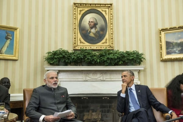 Indian Prime Minister Narendra Modi (L) makes a statement to the press as U.S. President Barack Obama listens after a meeting in the Oval Office of the White House on September 30, 2014. (Brendan Smialowski/Getty Images)