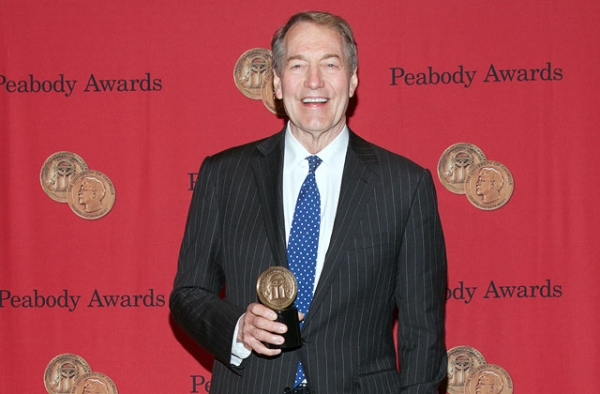"Television journalist Charlie Rose holds the Peabody Award he won for his ""One-on-One with Assad"" interview on May 19, 2014 in New York City. (Peabody Awards/Flickr)"