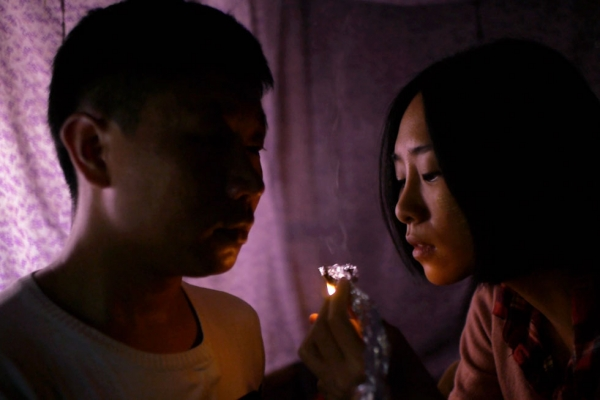 """Even though the characters deal drugs and traffic in humans,"" says Midi Z, ""they are just ordinary people."" Above, Xing-Hong (Wang Shin-Hong) and Sanmei (Wu Ke-Xi) in ""Ice Poison"" (2014)."