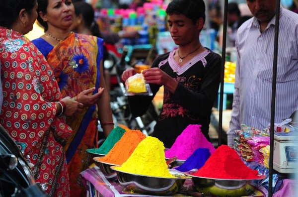 Women purchase colored powder for Holi celebrations at a roadside stall in the old city of Allahabad, India on March 4, 2015. Holi, the festival of colors, is an annual celebration of the coming of spring. During Holi celebrations, revelers spray colored powder and water on each other with great gusto. (Sanjay Kanojia/AFP/Getty Images)