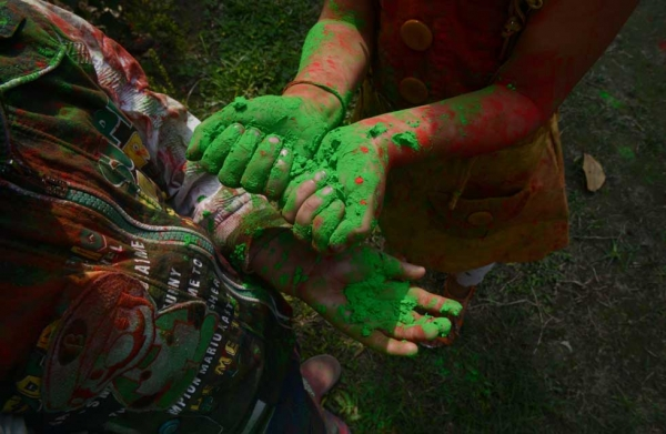 Children celebrate Holi in Siliguri, India on March 4, 2015 with fists full of colored powder known as gulal. (Diptendu Dutta/AFP/Getty Images)