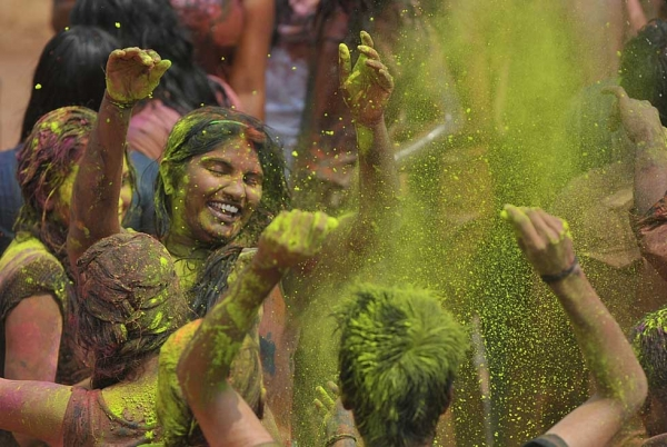 Revelers dance during Holi celebrations in Hyderabad, India on March 5, 2015. (Noah Seelam/AFP/Getty Images)