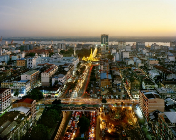 "Yangon's Sule Pagoda at dusk as seen from Trader's Hotel (now the ""Sule Shangri-la""). (Andrew Rowat)"