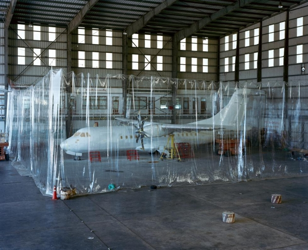 A plane waits to be painted in a hangar at Yangon International Airport. (Andrew Rowat)