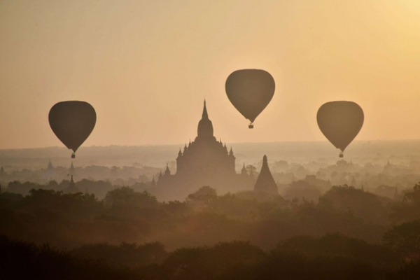 Hot air balloons fly over ancient temples in Bagan, Myanmar, at sunrise on November 25, 2014. (Phyo Hein Kyaw/AFP/Getty Images)