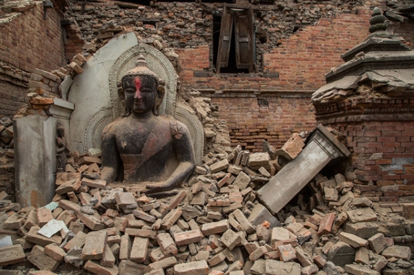 A Buddha statue is surrounded by debris from a collapsed temple in the UNESCO world heritage site of Bhaktapur on April 26, 2015 in Bhaktapur, Nepal. (Omar Havana/Getty Images)