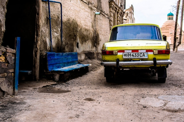 A beat up Russian Lada car parked on the streets of the 2,000 year old ancient city Bukhara, Uzbekistan on April 5, 2015. (Alex Steffler/Flickr)