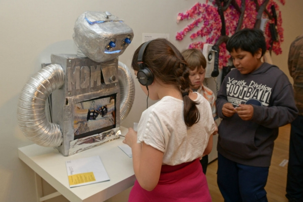 Children test the functionality of the Metallic Origami Maker, or M.O.M. robot. (Elsa Ruiz)
