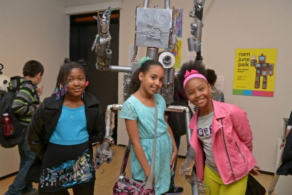 Student artists pose in the gallery in front of 4-2 D-2. (Elsa Ruiz)