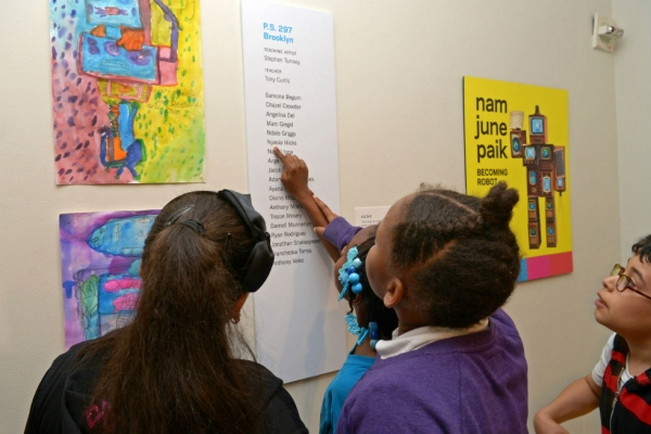 Student artists from P.S. 297 in Brooklyn find their names on the gallery wall. (Elsa Ruiz)