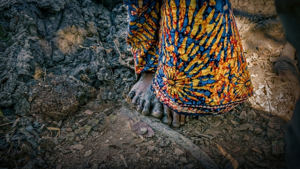 Feet caked in mud in Patuakhali, Bangladesh on January 26, 2015. (Armand Rajnoch/Flickr)