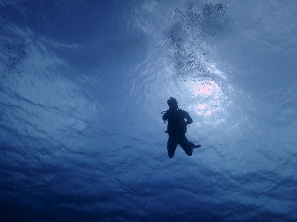 A scuba diver dives into deep waters in the Solomon Islands on May 10, 2015. (Kelsey Schwenk/Flickr)