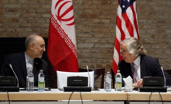U.S. Secretary of Energy Ernest Moniz (R) and Head of the Iranian Atomic Energy Organization Ali Akbar Salehi (L) meet at a hotel where the Iran nuclear talks meetings are being held in Vienna, Austria on July 9, 2015. (Carlos Barria/AFP/Getty Images)