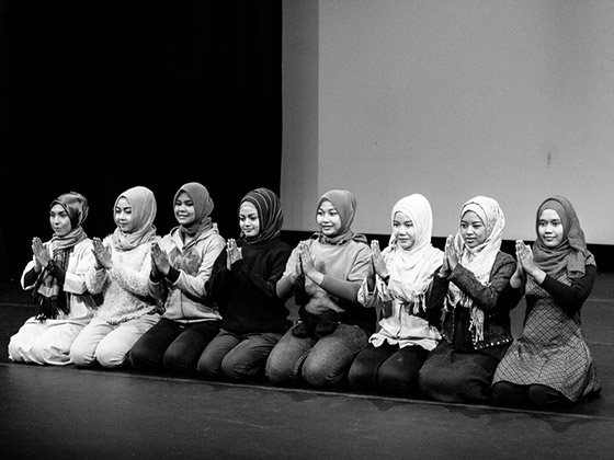 The Tari Aceh troupe performing a sitting dance at the workshop. (Vaishali Nayak)