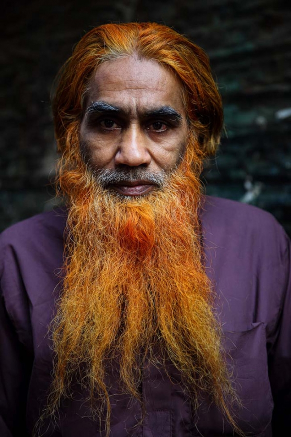 Portraits of men in Bangladesh who have dyed their hair and/or their beard using henna for an orange-red tint. Khairul Mollah with a flowing orange henna-dyed beard. (GMB Akash)