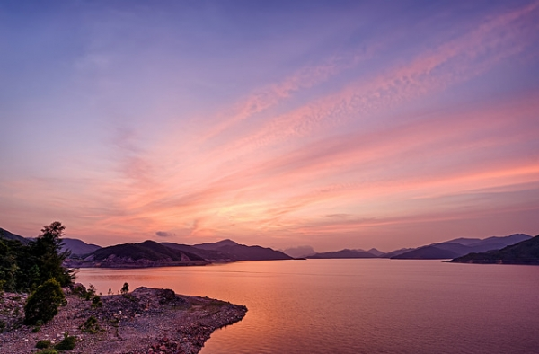 High Island Reservoir in Hong Kong is lit up in a purple glow under the setting sun on September 6, 2015. (johnlsl/Flickr)
