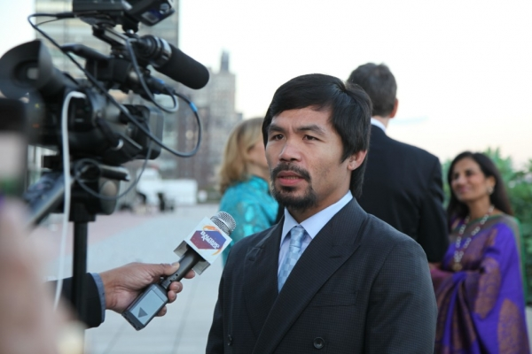Boxer and Game Changer of the Year Manny Pacquiao is interviewed by a reporter at the Asia Game Changers award ceremony on October 13, 2015. (Ellen Wallop/Asia Society)