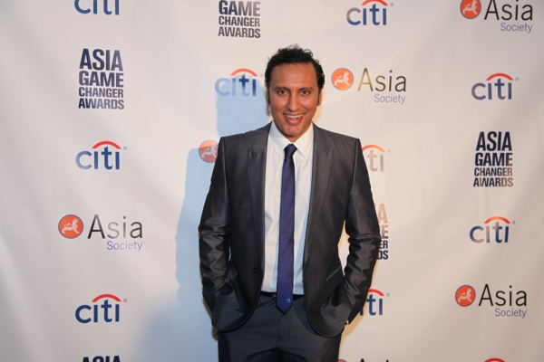 Comedian and Asia Game Changer awardee Aasif Mandvi poses at the Asia Game Changers award ceremony on October 13, 2015. (Ellen Wallop/Asia Society)