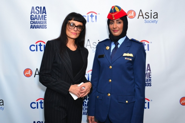 Fashion designer Norma Kamali poses with Asia Game Changer awardee Mariam al-Mansouri on October 13, 2015. (Jared Michael Siskin/Patrick McMullan)