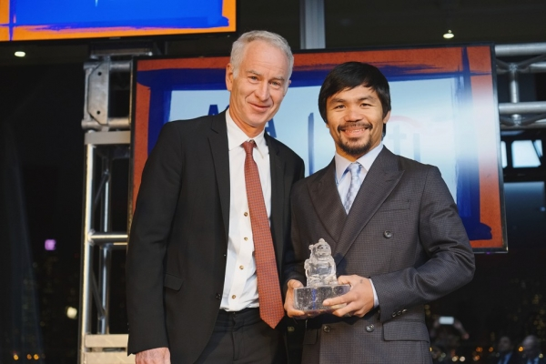 Tennis star John McEnroe poses with Asia Game Changer of the Year Manny Pacquiao on October 13, 2015. (Jamie Watts/Asia Society)
