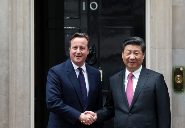 U.K. Prime Minister David Cameron (L) greets President Xi Jinping of China as he arrives in Downing Street on October 21, 2015 in London, England. (Carl Court/Getty Images)