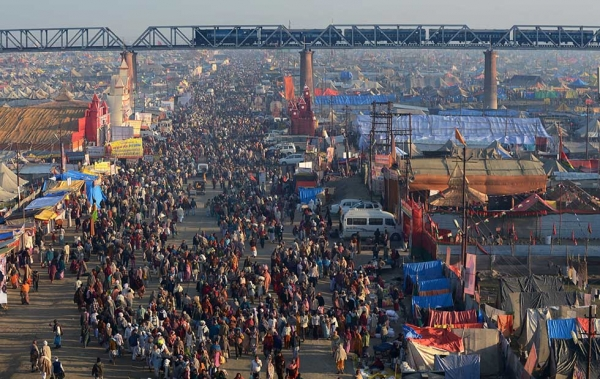 A large crowd makes its way on one of the pedestrian access points into the grounds of the Kumbh Mela, a day before authorities expect the largest crowd during the most auspicious day of the festival, in Allahabad on February 9, 2013. (Roberto Schmidt/AFP/Getty Images)