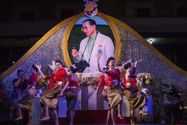 Thai dancers perform near the Grand Palace as the celebration for Thailand's King Bhumibol Adulyadej's 88th birthday begins on December 4, 2015 in Bangkok, Thailand. (Paula Bronstein/Getty Images)
