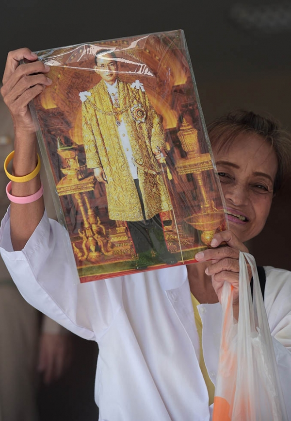 A Thai well-wisher holds a portrait of Thai King Bhumibol at Siriraj Hospital in Bangkok on June 1, 2015. (Pornchai Kittiwongsakul/AFP/Getty Images)