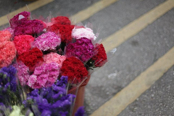 A bucket full of brightly colored carnations at the flower market in Kowloon, Hong Kong on November 21, 2015. (Tahiat Mahboob)