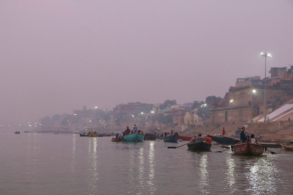 A row of boats wait by the banks of the Ganges river in Varanasi, India on November 23, 2015. (Juan Antonio F. Segal/Flickr)