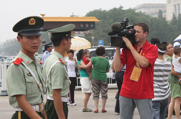 A foreign reporter films authorities in Beijing. (Noel Hidalgo/Flickr)