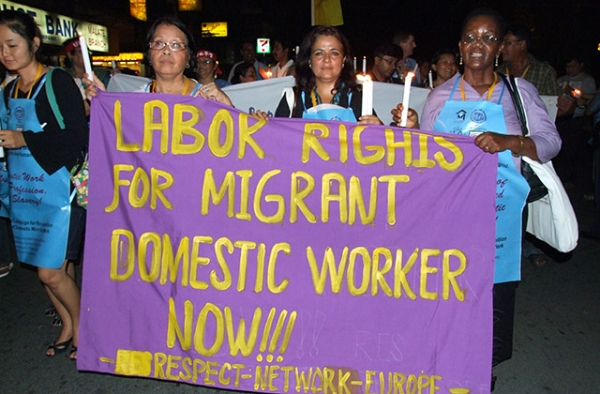 Filipino domestic workers attend a demonstration for migrant laborer rights. (ILO in Asia and the Pacific/Flickr)
