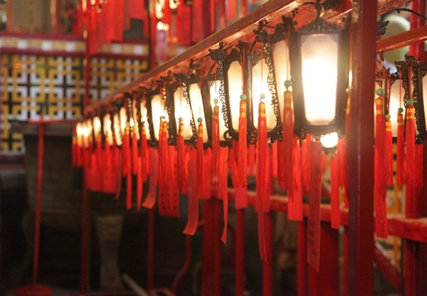 Red lanterns hanging in a row cast a golden glow inside Mo Man Temple in Hong Kong on November 15, 2015. (Tahiat Mahboob)