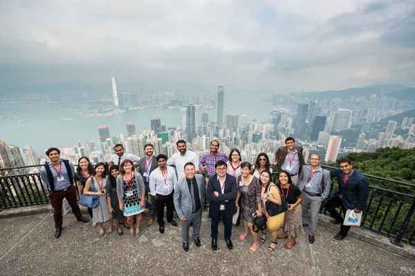 Attendees of Asia Society's Asia 21 Summit pose in front of the Hong Kong skyline on December 2, 2015. The attending Asia 21 Young Leaders discussed various best practices in leadership and what new generations may do to create new opportunities for partnerships, sustainability, and cooperation. (Tahiat Mahboob/Asia Society)