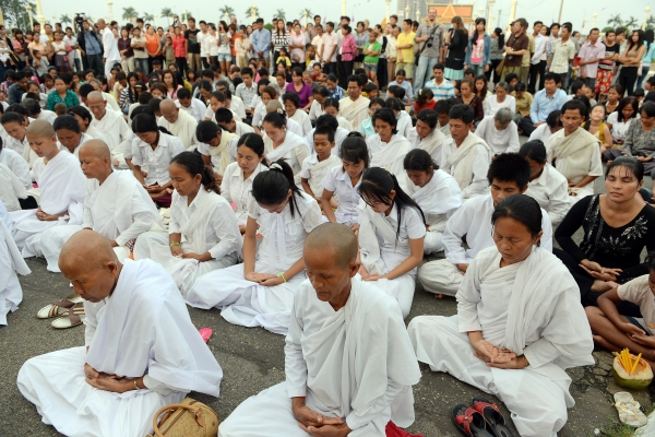 Cambodian monks, nuns and other citizens pray in front of the Royal Palace in Phnom Penh on October 15, 2012 in remembrance of their former king. Sihanouk's passing overnight fell poignantly during the solemn festival of the dead. (Tang Chhin Sothy/AFP/Getty Images)