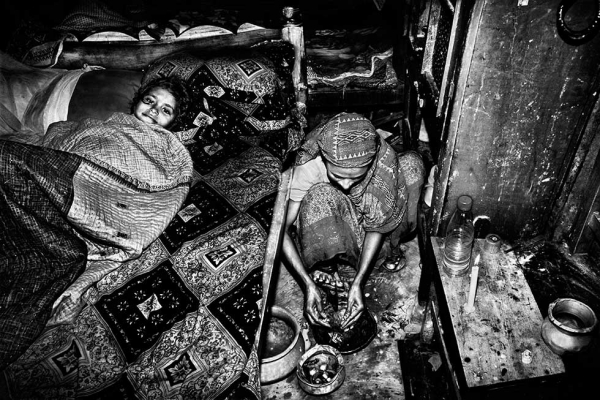Hena prepares supper after nine hours at the factory in Dhaka. (Gazi Nafis Ahmed)